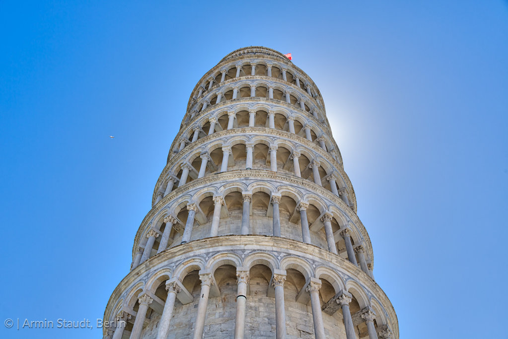 Leaning tower of Pisa isolated on the blue sky