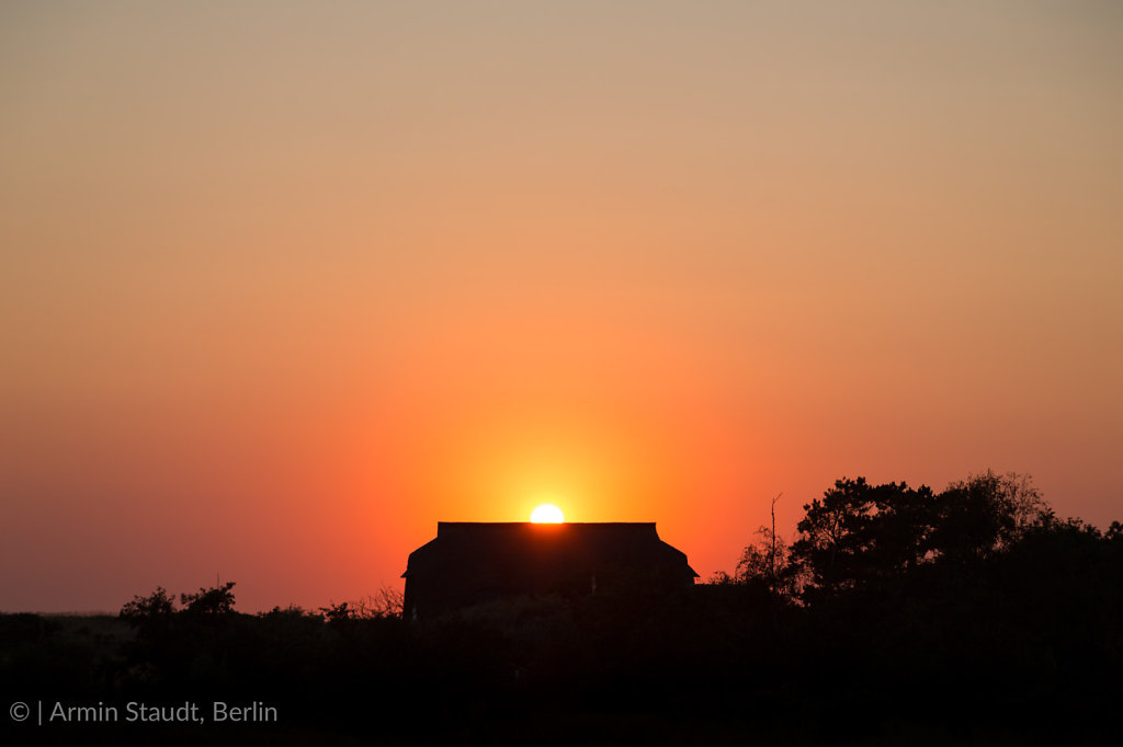 sunset behind a cottage at Hiddensee island