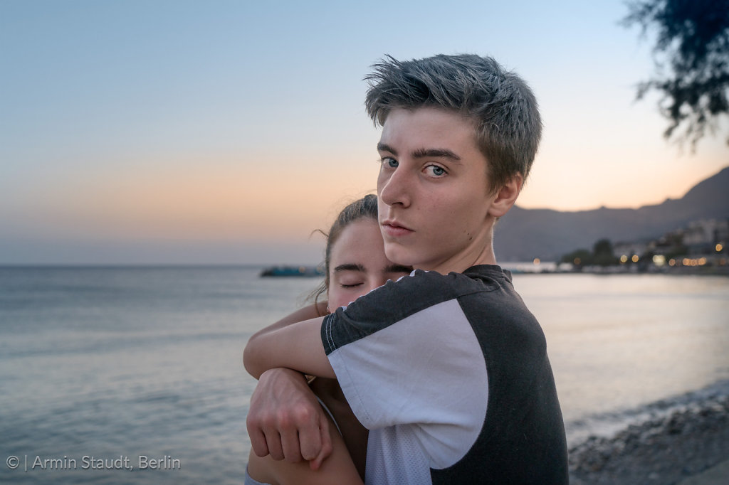 Young couple in the evening at the sea
