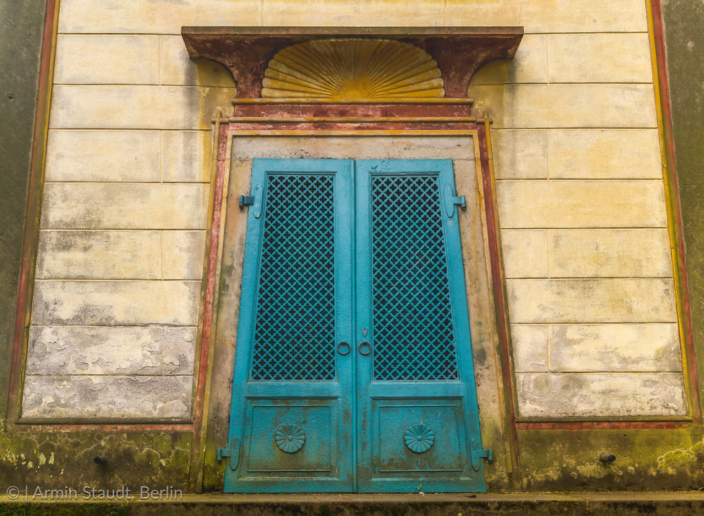 turquoise old Egyptian gate to a tomb