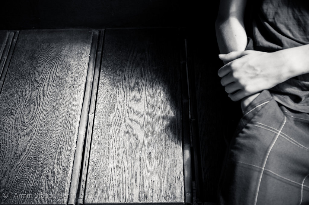 black and white shot of a boy with his hands in the pocket