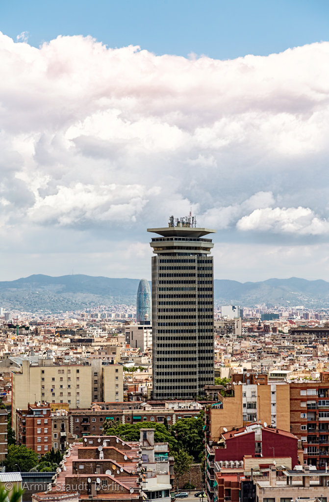 HDR shot of a skyscraper in barcelona, with cloudescape