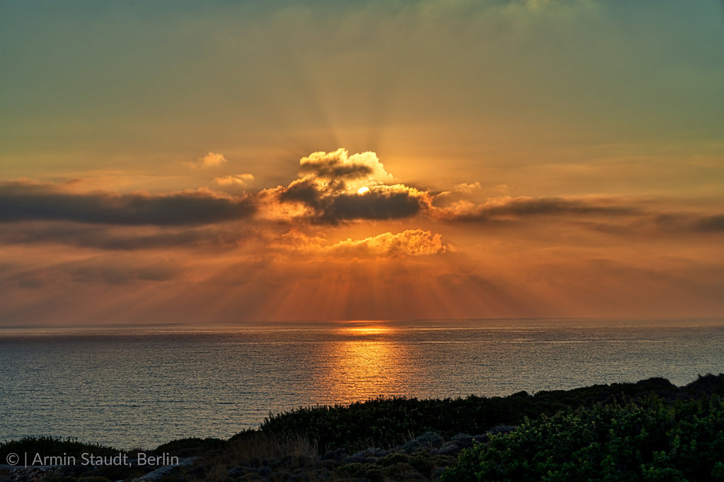 sunset over the sea with dramatic clouds