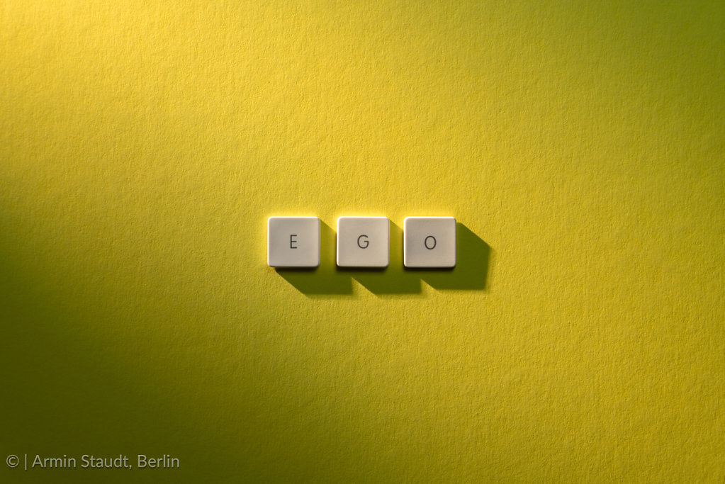 description of the word Ego on yellow background