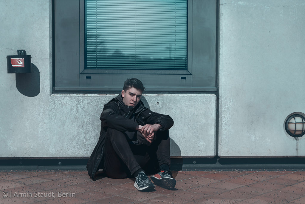 portrait of a young man, sitting on the floor