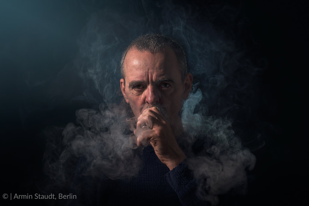 portrait of a man with vaporizer and smoke