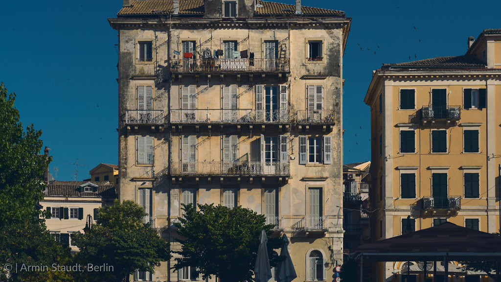 Old run down house in Corfu with blue sky